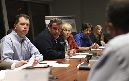 Chief of Staff Kevin O'Dowd, Governor Chris Christie, Lt. Governor Kim Guadagno and Chief Counsel Charlie McKenna (L-R) are briefed by New Jersey Homeland Security Director Edward Dickson (far R) during a meeting with Office of Emergency Management, cabinet members and senior staff in preparation of Hurricane Sandy at the Regional Operations Intelligence Center (ROIC) in West Trenton, New Jersey on October 27, 2012. REUTERS/Governor's Office/Tim Larsen/Handout