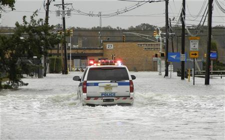 A Port Authority Police SUV makes its way through flood waters covering roads leading toward Teterboro Airport in Teterboro, New Jersey, October 30, 2012. REUTERS/Chelsea Emery