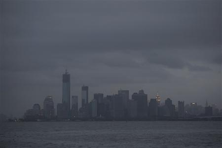 The skyline of lower Manhattan sits in darkness after a preventive power outage caused by Hurricane Sandy in New York October 30, 2012. REUTERS/Keith Bedford