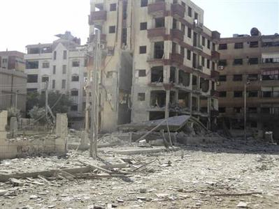 Damaged buildings are pictured after activists say a Syrian Air Force fighter jet loyal to Syria's President Bashar al-Assad fired missiles at Duma, near Damascus October 30, 2012. REUTERS/Abed Al-Kareem Muhammad/Shaam News Network/Handout