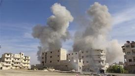Smoke rises after a Syrian Air Force fighter jet loyal to Syria's President Bashar al-Assad fired missiles at Marat al-Numan, near the northern province of Idlib October 30, 2012. REUTERS/Zakwan Hadeed/Shaam News Network/Handout