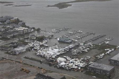 Damage after Hurricane Sandy made landfall on the southern New Jersey coastline is seen in this U.S. Coast Guard handout photo in Brigantine, New Jersey, October 30, 2012. REUTERS/U.S.Coast Guard/Petty Officer 2nd Class Erik Swanson/Handout