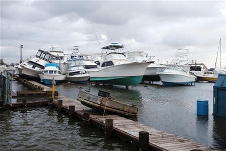 Boats are seen piled up after being thrown off their stands by Hurricane Sandy at a marina in Bay Shore, New York, October 30, 2012. REUTERS-Lucas ackson