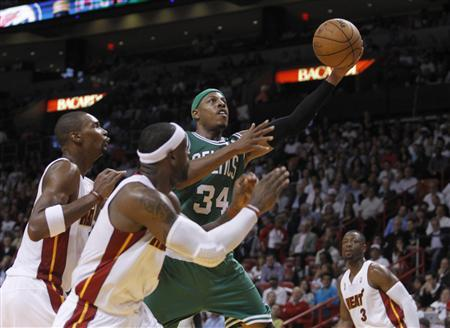 Boston Celtics forward Paul Pierce (C) drives to the basket as Miami Heat defenders (L-R) Chris Bosh, LeBron James and Dwyane Wade pursue in the second half during their NBA basketball game in Miami, Florida, October 30, 2012. REUTERS/Andrew Innerarity