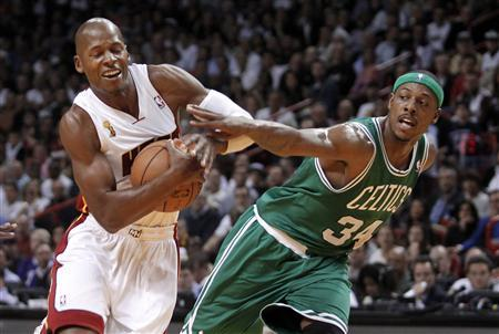 Boston Celtics forward Paul Pierce (R) fouls Miami Heat guard Ray Allen in the first half of their NBA basketball game in Miami, Florida October 30, 2012. REUTERS/Andrew Innerarity