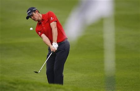 Justin Rose of England hits a shot on the 15th hole during the BMW Masters 2012 golf tournament at Lake Malaren Golf Club in Shanghai, October 25, 2012. REUTERS/Carlos Barria