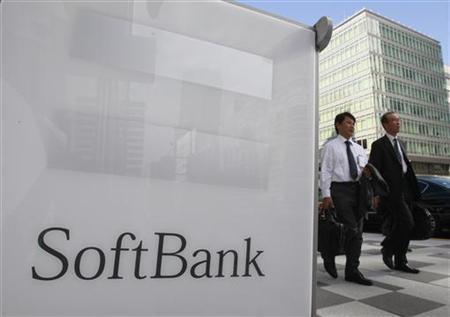 Pedestrians walk past a Softbank Corp branch in Tokyo October 15, 2012. REUTERS/Yuriko Nakao