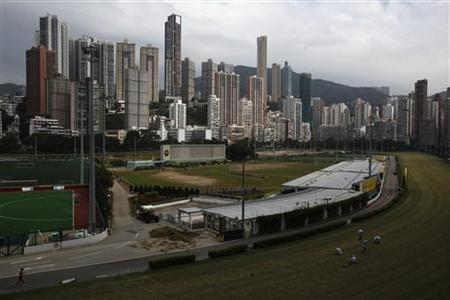 Luxurious residential blocks are seen behind Happy Valley horse racing track in Hong Kong October 26, 2012. REUTERS/Bobby Yip