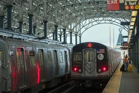 A New York City subway train enters the Coney Island station prior to a total subway shutdown at 7pm in New York, October 28, 2012. REUTERS/Keith Bedford