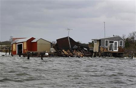 Fishing huts destroyed by Hurricane Sandy are seen on an island near Fire Island, New York October 30, 2012. REUTERS/Lucas Jackson