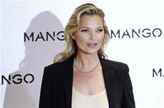 British model Kate Moss poses during the launch of the new Mango 2012 collection in London January 24, 2012. REUTERS/Stefan Wermuth