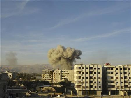 Smoke rises after a Syrian Air Force fighter jet loyal to Syria's President Bashar al-Assad fired missiles at Hamouria, near Damascus October 29, 2012. REUTERS/Shaam News Network/Handout