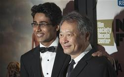 "Cast member Suraj Sharma (L) and Director Ang Lee attend the opening night gala presentation of film ""Life Of Pi"" at the 50th New York Film Festival at Alice Tully Hall in New York September 28, 2012. REUTERS/Andrew Kelly"