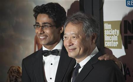 Cast member Suraj Sharma (L) and Director Ang Lee attend the opening night gala presentation of film 'Life Of Pi' at the 50th New York Film Festival at Alice Tully Hall in New York September 28, 2012. REUTERS/Andrew Kelly