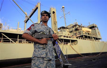 An Iranian soldier stands guard near Iranian Navy helicopter carrier Kharg at Port Sudan at the Red Sea State, October 31, 2012.REUTERS/ Mohamed Nureldin Abdallah