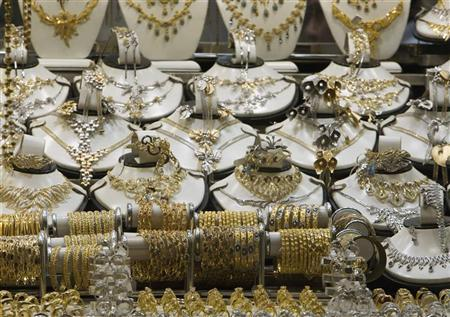 Gold jewellery is displayed in a shop at Tehran's Grand Bazaar October 8, 2009. REUTERS/Raheb Homavandi