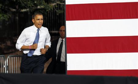 U.S. President Barack Obama jogs into a campaign rally in Las Vegas, Nevada October 24, 2012. Obama is on a two-day, eight state, campaign swing. REUTERS/Kevin Lamarque