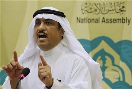 Former member of Kuwaiti parliament Musallam al-Barrak gestures while speaking to journalists at Parliament's media center in Kuwait City November 20, 2011. REUTERS/Hamad I Mohammed