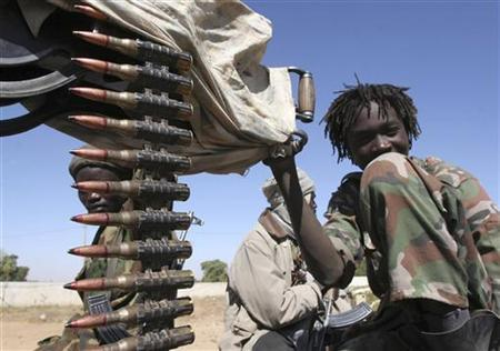 A child soldier from one of the many rebel groups operating along the Chad-Sudan border holds a gun in eastern Chad February 3, 2007. REUTERS/Emmanuel Braun