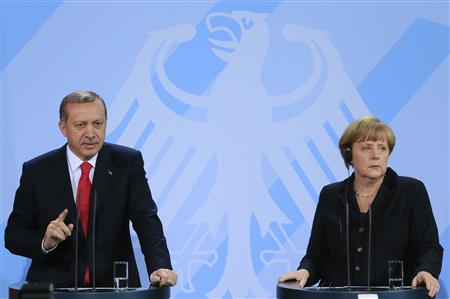 German Chancellor Angela Merkel (R) and Turkish Prime Minister Tayyip Erdogan address the media after talks in Berlin October 31, 2012. REUTERS/Tobias Schwarz