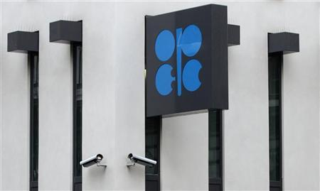 The logo of the Organization of the Petroleum Exporting Countries (OPEC) is pictured next to security cameras on the outside of the new OPEC headquarters in Vienna March 16, 2010. REUTERS/Heinz-Peter Bader