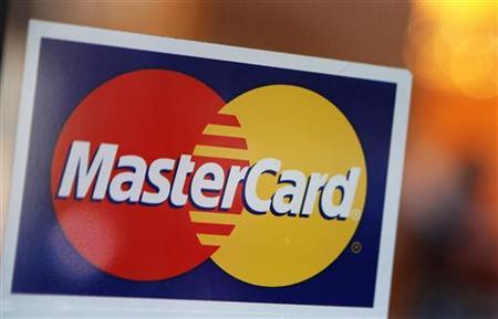 A MasterCard logo is seen on a door outside a restaurant in New York, February 3, 2010. REUTERS/Shannon Stapleton
