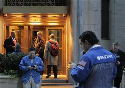 Traders stand outside the New York Stock Exchange prior to the opening bell in New York October 31, 2012. U.S. stocks edged higher on Wednesday in the first trading session since the massive storm Sandy in the U.S. Northeast forced a two-day market closure. REUTERS/Brendan McDermid