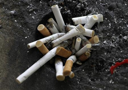 Cigarette butts in an ashtray in Los Angeles, California, May 31, 2012. REUTERS/Jonathan Alcorn