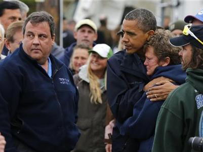 U.S. President Barack Obama (3rd L) hugs North Point Marina owner Donna Vanzant as he tours damage done by Hurricane Sandy in Brigantine, New Jersey, October 31, 2012. REUTERS/Larry Downing