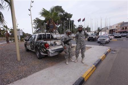 Members of the Libyan security forces stand guard close to the headquarters of the General National Congress in Tripoli October 31, 2012. REUTERS/Ismail Zitouny