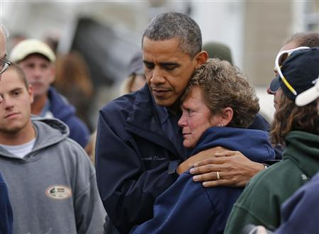 U.S. President Barack Obama hugs North Point Marina owner Donna Vanzant as he tours damage done by Hurricane Sandy in Brigantine, New Jersey, October 31, 2012. REUTERS/Larry Downing