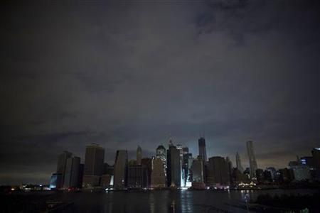 A largely unlit downtown Manhattan stands under a night sky due to a power blackout caused by Hurricane Sandy in New York October 30, 2012. REUTERS/Andrew Kelly