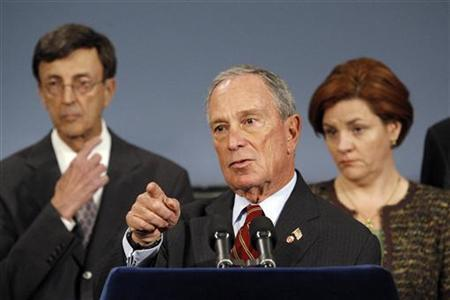 New York Mayor Michael Bloomberg (C) speaks to the media during a news conference about Updates to New Yorkers on Preparations for Hurricane Sandy in New York, October 26, 2012. REUTERS/Eduardo Munoz