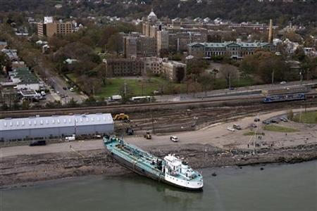 An aerial photo shows the John B. Caddell, a 700-ton water tanker, grounded in New York October 31, 2012. REUTERS/Adrees Latif