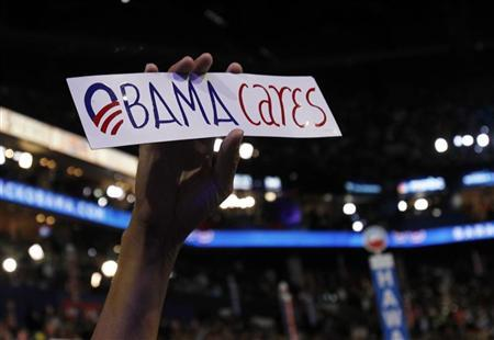 A delegate holds an ''Obama cares'' bumper sticker during the final session of the Democratic National Convention in Charlotte, North Carolina September 6, 2012. REUTERS/Jessica Rinaldi