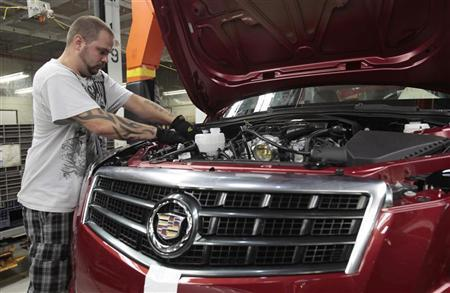 General Motors assembly worker Brandon Spritser works on an all new 2013 ATS Cadillac luxury vehicle at the Lansing Grand River Assembly Plant in Lansing, Michigan July 26, 2012. REUTERS/Rebecca Cook
