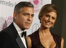 Actor George Clooney and girlfriend Stacy Keibler arrive at the 26th Carousel of Hope Ball in Beverly Hills, California October 20, 2012. REUTERS/Fred Prouser