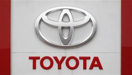 The Toyota logo is seen outside a Japan's Toyota Motor Corp car dealership in Hoenheim near Strasbourg, eastern France October 10, 2012. REUTERS/Vincent Kessler