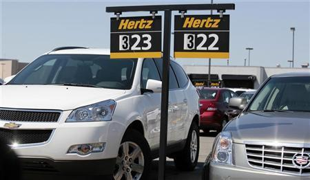 Hertz rental cars are parked in a rental lot near Detroit Metropolitan airport in Romulus, Michigan May 9, 2011. REUTERS/Rebecca Cook