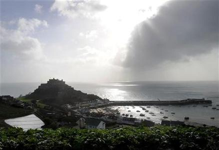 The village of Gorey Harbour and Mont Orgueil castle are seen in Jersey in this March 1, 2008 file photo. REUTERS/Toby Melville