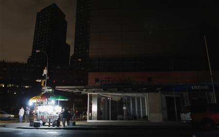 A food cart is the only light in a neighborhood in the aftermath of Hurricane Sandy in New York October 31, 2012. REUTERS/Carlo Allegri