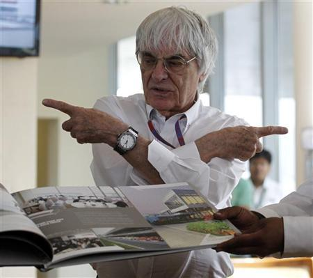 Formula One supremo Bernie Ecclestone gestures during the presentation of a commemorative book presented to him on the occasion of his birthday at the Indian F1 Grand Prix at the Buddh International Circuit in Greater Noida, on the outskirts of New Delhi, October 28, 2012. REUTERS/Vivek Prakash