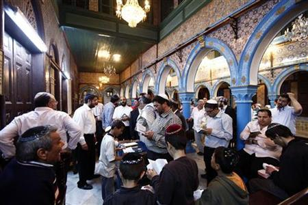 Jewish men pray inside the blue-tiled El Ghriba synagogue on the Tunisian island of Djerba following a wedding ceremony May 10, 2012. REUTERS/Anis Mili