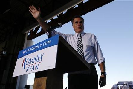 Republican presidential nominee Mitt Romney waves to the crowd at a campaign rally in Tampa, Florida October 31, 2012. REUTERS/Brian Snyder