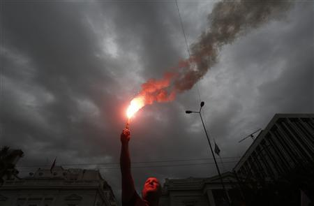 A coast guard officer waves a red flare outside the parliament as he takes part in an anti-austerity protest, with other officers and members of police, coast guard and fire brigade unions, in Athens November 1, 2012. REUTERS/John Kolesidis
