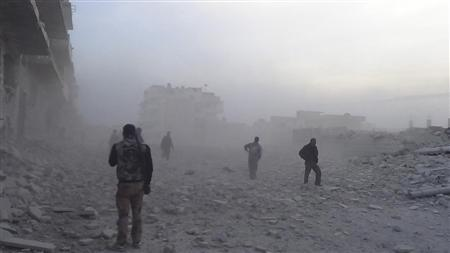 Free Syrian Army fighters walk near a building damaged after a Syrian Air Force fighter jet loyal to Syria's President Bashar al-Assad fired missiles at Marat al-Numan near the northern province of Idlib October 31, 2012. REUTERS/Zakwan Hadeed/Shaam News Network/Handout