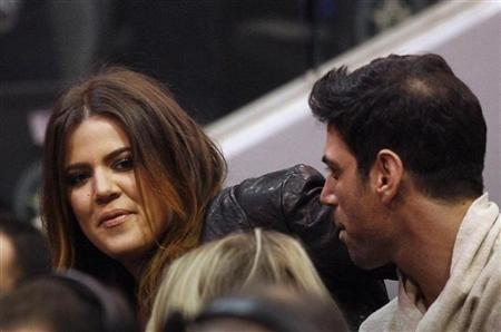 Celebrity Khloe Kardashian (L) watches the second half of the NBA basketball game between the Dallas Mavericks and the Miami Heat in Dallas, Texas December 25, 2011. REUTERS/Mike Stone