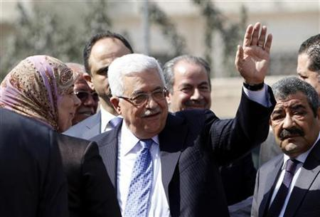 Palestinian President Mahmoud Abbas waves as he arrives to vote in municipal elections at a polling station in Al-Bireh, next to the West Bank city of Ramallah, October 20, 2012. REUTERS/Mohamad Torokman