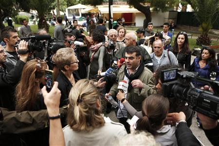 Greek editor Costas Vaxevanis makes statements outside a courthouse in Athens November 1, 2012. REUTERS/Yorgos Karahalis
