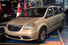 A new 2011 Chrysler Town & Country minivan is displayed during a celebration ceremony for the production launch of the new 2011 Dodge Grand Caravan and Chrysler Town & Country mnivans at the Windsor Assembly Plant in Windsor, Ontario January 18, 2011. REUTERS/Rebecca Cook
